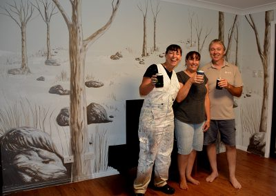 clients with living room mural