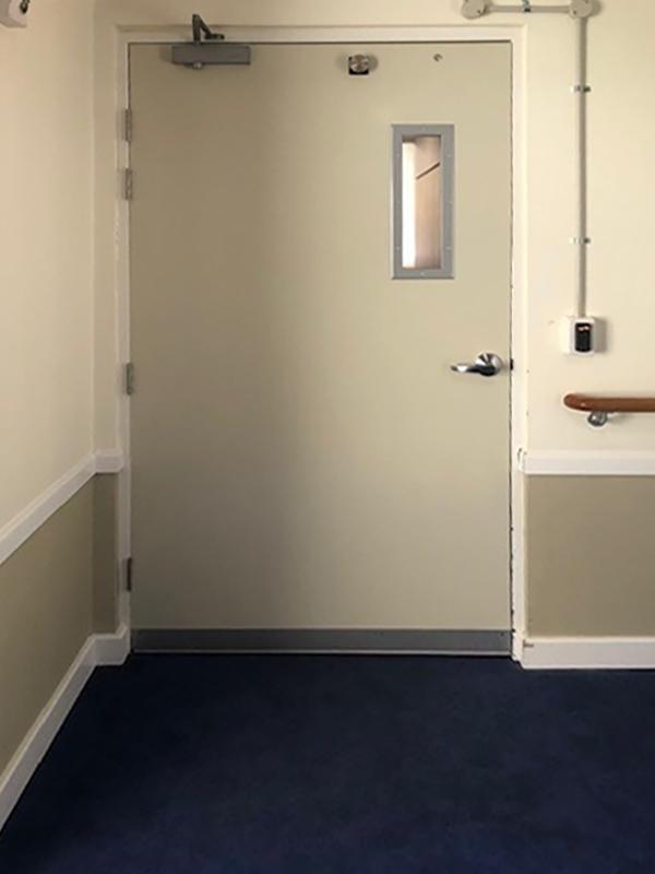 before door disguise for dementia exit seekers
